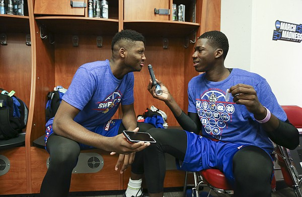 Kansas Jayhawks forward Carlton Bragg Jr. smells an antiperspirant stick left in forward Cheick Diallo's locker as the two goof around while performing a mock commercial on Wednesday, March 23, 2016 at KFC Yum! Center in Louisville, Kentucky.