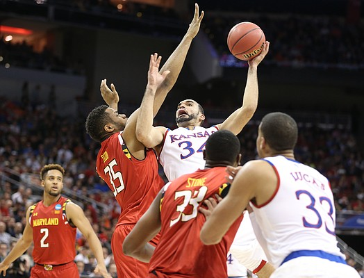 Kansas Jayhawks forward Perry Ellis (34) gets to the bucket against Maryland forward Damonte Dodd (35) during the first half, Thursday, March 24, 2016 at KFC Yum! Center in Louisville, Kentucky.
