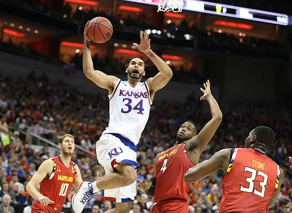 Kansas Jayhawks forward Perry Ellis (34) gets to the bucket past Maryland forward Robert Carter (4) during the first half, Thursday, March 24, 2016 at KFC Yum! Center in Louisville, Kentucky.