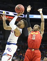 Kansas Jayhawks guard Frank Mason III (0) gets to the bucket past Maryland guard Rasheed Sulaimon (0) during the first half, Thursday, March 24, 2016 at KFC Yum! Center in Louisville, Kentucky.