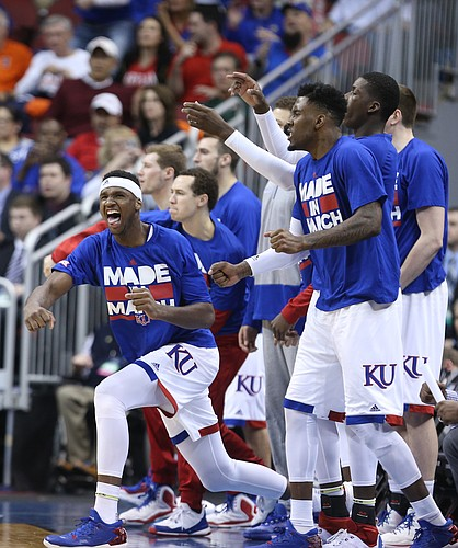 Kansas forward Carlton Bragg Jr., left, and players on the Jayhawks' bench erupt in the second half after a three by KU guard Wayne Selden Jr., Thursday, March 24, 2016 at KFC Yum! Center in Louisville, Ky.