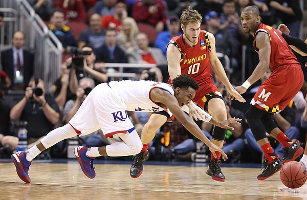 Kansas guard Devonte' Graham (4) lays out for a loose ball with Maryland forward Jake Layman (10) and guard Rasheed Sulaimon (0) during the second half, Thursday, March 24, 2016 at KFC Yum! Center in Louisville, Kentucky.