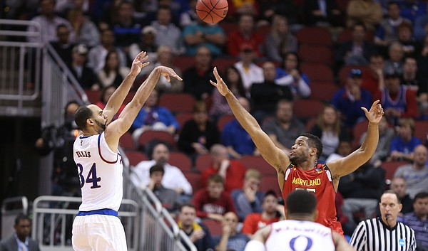 Kansas Jayhawks forward Perry Ellis (34) puts a shot over Maryland forward Damonte Dodd during the second half, Thursday, March 24, 2016 at KFC Yum! Center in Louisville, Kentucky.