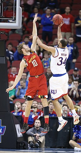 Kansas Jayhawks forward Perry Ellis (34) gets a shot off against Maryland forward Jake Layman (10) during the second half, Thursday, March 24, 2016 at KFC Yum! Center in Louisville, Kentucky.