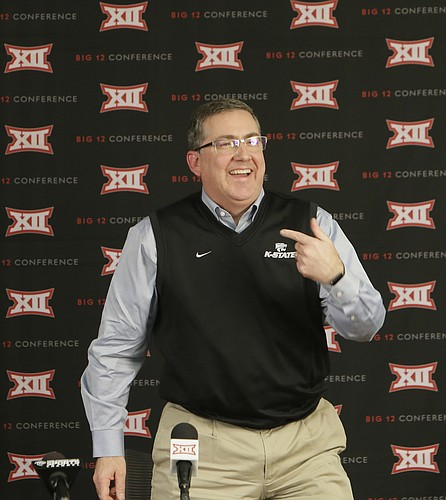 Kansas State president Kirk Schulz laughs after speaking to reporters after the Big 12 conference meeting Friday, Feb. 5, 2016, in Irving, Texas. Schulz will soon leave K-State to become president at Washington State University. (AP Photo/LM Otero)