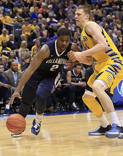 Villanova forward Kris Jenkins, left, drives to the basket against Marquette forward Henry Ellenson, right, during the second half of an NCAA college basketball game Saturday, Feb. 27, 2016, in Milwaukee. Villanova defeated Marquette 89-79. (AP Photo/Darren Hauck)