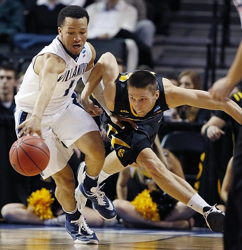 Villanova guard Jalen Brunson (1) holds back Iowa forward Jarrod Uthoff (20) during the second half of a second-round NCAA men's college basketball tournament game, Sunday, March 20, 2016, in New York. (AP Photo/Kathy Willens)