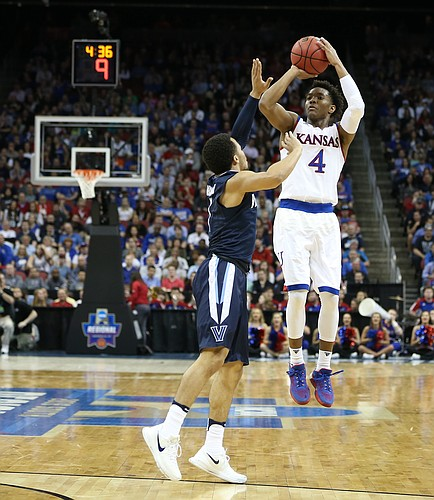 Kansas guard Devonte' Graham (4) pulls up for a three in front of Villanova guard Jalen Brunson (1) during the first half, Saturday, March 26, 2016 at KFC Yum! Center in Louisville, Kentucky.