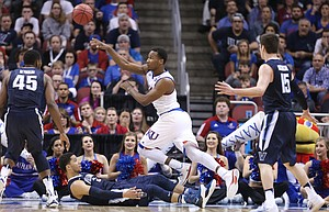 Kansas guard Wayne Selden Jr. (1) throws a baseline pass over Villanova guard Josh Hart (3) during the second half, Saturday, March 26, 2016 at KFC Yum! Center in Louisville, Kentucky.