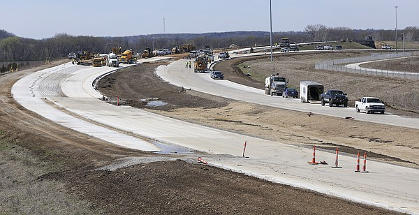 Construction work continues Monday, March 28, 2016, on a section of the west leg of the South Lawrence Trafficway where it passes over Iowa St.  This view looks to the west toward the overpass bridge over Iowa St. with the east and westbound lanes of the SLT curving through the foreground. The east leg is still under construction but on track for completion in fall of 2016.