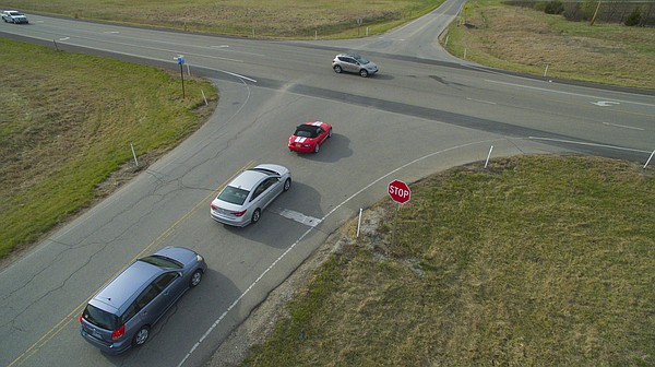 Motorists along East 1200 Road approach a stop sign at an intersection that connects East 1200 Road and the South Lawrence Trafficway just south of the Kasold curve on Tuesday, March 29, 2016.
