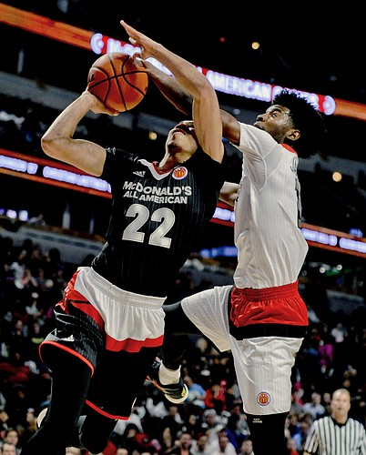West forward Josh Jackson, right, from Justin-Siena high school/Prolific Prep Academy in Napa, Calif., blocks East forward Jayson Tatum from Chaminade College Preparatory school in St. Louis during the McDonald's All-American boys basketball game, Wednesday, March 30, 2016, in Chicago. (AP Photo/Matt Marton)