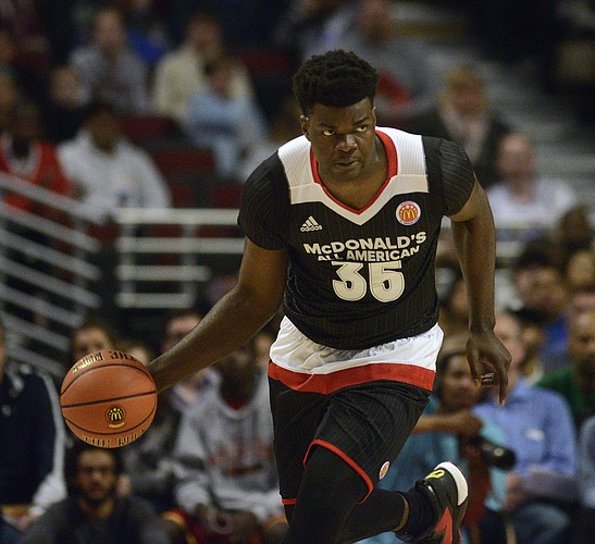 East center Udoka Azubuike, from Potter's House Christian in Jacksonville, Fla. dribbles the ball during the McDonald's All-American boys basketball game, Wednesday, March 30, 2016, in Chicago. (AP Photo/Matt Marton)