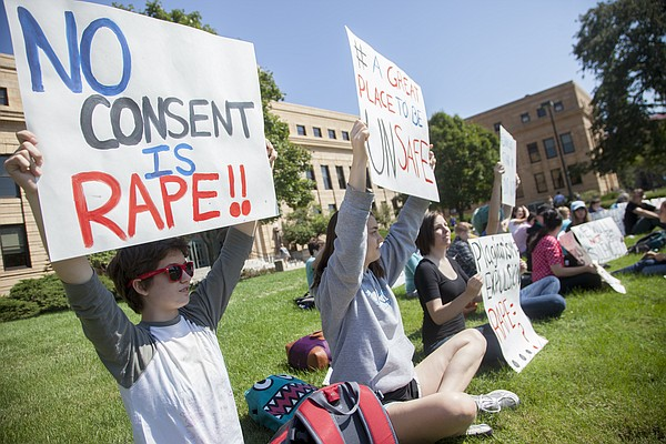 In this file photo from Sept. 16, 2014, demonstrators sit outside Strong Hall to protest Kansas University's handling of sexual assault investigations.