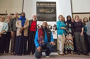 Jameel Syed, center, poses for a photograph with members of the audience after speaking about building interfaith relationships Sunday morning at Trinity Lutheran Church, 1245 New Hampshire St. In 2015, Syed, a Muslim, became the first person to recite the Adhan, or Islamic Call to Prayer, along with the last sermon of the Prophet Muhammad in all 50 states in only 35 days.