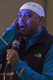 Jameel Syed recites the Islamic call to prayer after speaking about building interfaith relationships Sunday morning at Trinity Lutheran Church, 1245 New Hampshire St. In 2015, Syed, a Muslim, became the first person to recite the Adhan, or Islamic call to prayer, along with the last sermon of the Prophet Muhammad in all 50 states in only 35 days.