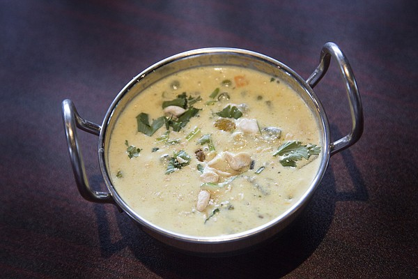 The newly opened Bayleaf Indian Restaurant and Bar, 947 New Hampshire St., serves up a variety of traditional Indian food, including this creamy coconut-based soup made with carrots and peas called navratan korma.