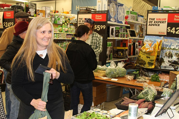 inda Cottin buys produce at the local farmers market in her hardware store. Linda is an advocate for farmers markets, Farm-to-School programs and school gardens.
