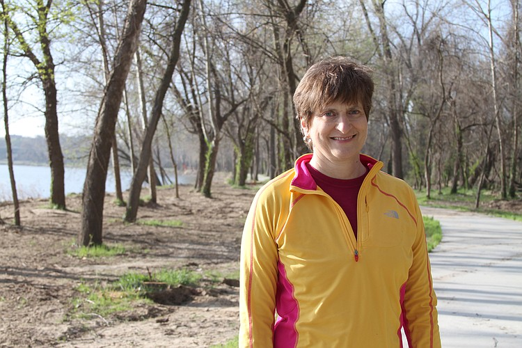 Marilyn Hull walks on a new trail that is along the Kansas River between Burcham Park and Constant Park. Hull is chair of the Lawrence Pedestrian-Bike Issues Task Force and is chair-elect of the Healthy Built Environment work group for LiveWell Lawrence.