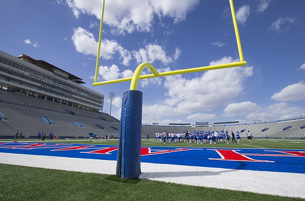 The Kansas Jayhawks come together for a huddle during the beginning of practice, Thursday, April 7, 2016 at Memorial Stadium.