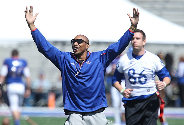 Denver Broncos cornerback and Kansas alum, Chris Harris Jr. celebrates after his team scored a touchdown during Alumni Game prior to the Spring Game on Saturday, April 9, 2016 at Memorial Stadium. Harris served as one of the coaches.