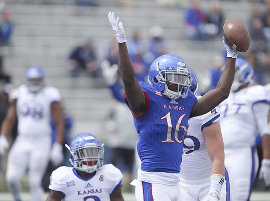 Kansas wide receiver Steven Sims Jr. (16) throws up his arms after falling into the end zone for a touchdown during the Spring Game on Saturday, April 9, 2016 at Memorial Stadium.