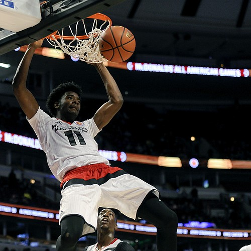 West forward Josh Jackson, from Justin-Siena in Napa, Calif., dunks against the East team during the McDonald's All-American boys basketball game, Wednesday, March 30, 2016, in Chicago. The West beat the East 114-107.