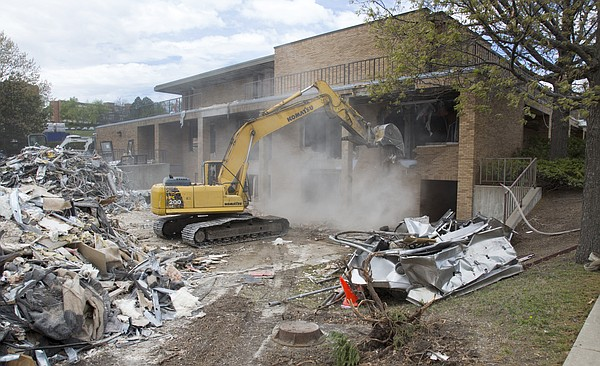 Demolition work begins at the Burge Union in Kansas University's central district, Monday, April 11, 2016. For more on the services and offices housed in the building: http://ljworld.com/burge