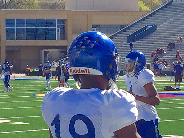 Mini-Jayhawk stickers now adorn the back of the helmets of KU's defensive players.