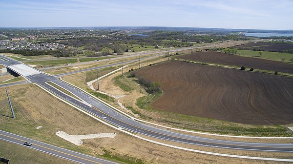 A view looking southeast shows the overpass where Bob Billings Parkway meets the South Lawrence Trafficway on Thursday, April 14, 2016. A residential development is being proposed for the farmland area southwest of the interchange.
