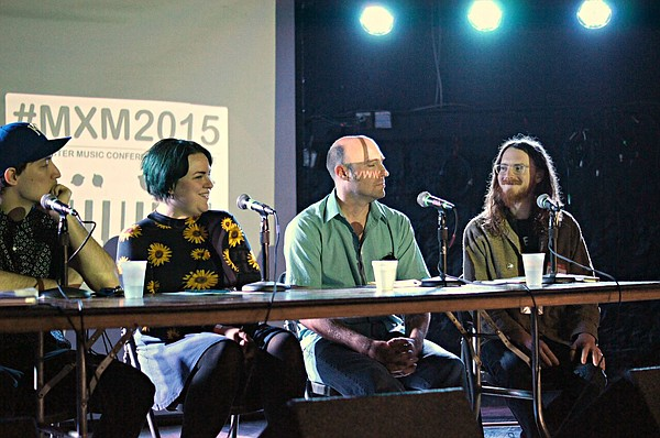 From left: Isaac Flynn of the Kansas City-based band Hembree, Katlyn Conroy of Lawrence's La Guerre, Bill Sundahl of Kansas City's KKFI 90.1 FM, and Whatever Forever Tapes co-founder Rolf Petermann participate in a panel during the 2015 MixMaster music conference. This year's conference will be held Saturday from 11 a.m. to 5 p.m. at the Lawrence Public Library, 707 Vermont St.