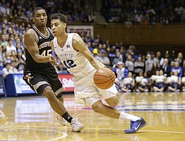 Louisville's Donovan Mitchell (45) guards Duke's Derryck Thornton (12) during the second half of an NCAA college basketball game in Durham, N.C., Monday, Feb. 8, 2016. Duke won 72-65. (AP Photo/Gerry Broome)