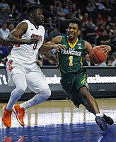 San Francisco guard Devin Watson (1) drives around Pepperdine guard Amadi Udenyi during the first half of a West Coast Conference tournament NCAA college basketball game Saturday, March 5, 2016, in Las Vegas. (AP Photo/John Locher)