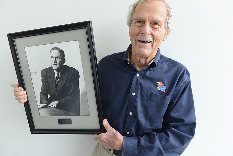 Bob Nash holding his favorite photo of his father, Dr. Bert Nash.