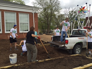 Volunteers work on New York Elementary's new butterfly garden on Saturday, April 16, 2016.
