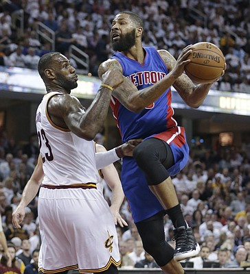 Detroit Pistons' Marcus Morris, right, drives past Cleveland Cavaliers' LeBron James in the second half in Game 2 of a first-round NBA basketball playoff series, Wednesday, April 20, 2016, in Cleveland. The Cavaliers won 107-90. (AP Photo/Tony Dejak)