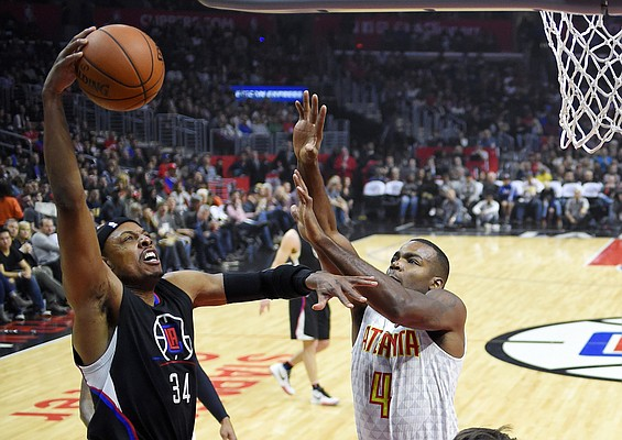 Los Angeles Clippers forward Paul Pierce, left, shoots as Atlanta Hawks forward Paul Millsap defends during the first half of an NBA basketball game, Saturday, March 5, 2016, in Los Angeles. (AP Photo/Mark J. Terrill)
