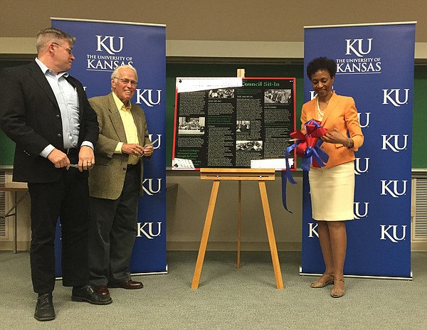 Shawn Alexander, Kansas University associate professor of African and African-American Studies and director of KU's Langston Hughes Center (left), Bill Tuttle, professor emeritus of American Studies, and Bernadette Gray-Little, chancellor, cut the ribbon during a ceremony to unveil a Strong Hall sit-in marker on Wednesday, May 4, 2016. The marker, highlighting a student civil rights protest of March 8, 1965, is to be hung outside the chancellor's suite on the second floor of Strong Hall.