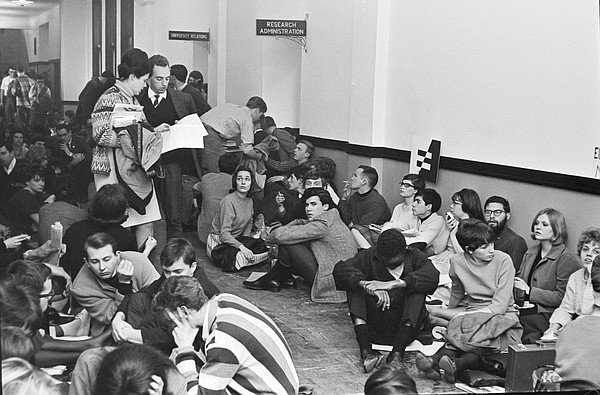On March 8, 1965, about 150 members of the Civil Rights Council, an organization of both black and white students, sat down in the hallway near W. Clarke Wescoes office in Strong Hall at about 10:30 a.m. with the goal of bringing attention to the administrations tacit approval of discrimination in campus housing and University-sanctioned organizations, particularly fraternities and sororities.