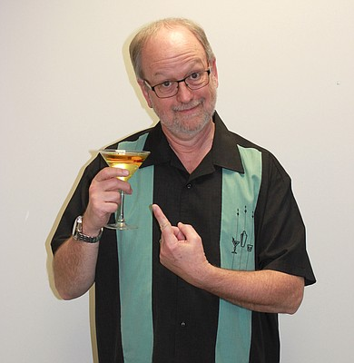 """Darrell Brogdon, pictured here, is the host of Kansas Public Radio's """"Retro Cocktail Hour."""" The program, which celebrates Brogdon's love of """"Space Age bachelor pad music,"""" will celebrate its 20th anniversary Saturday at 8 p.m. with a concert and party at Liberty Hall, 644 Massachusetts S."""