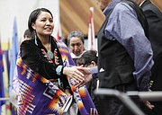 Amanda Blackhorse greets other guests during the Haskell Indian Nations University 2016 commencement ceremony Friday, May 6, 2016 on the HINU campus in Lawrence, Kan. Blackhorse, a former Haskell graduate gave the commencement address.