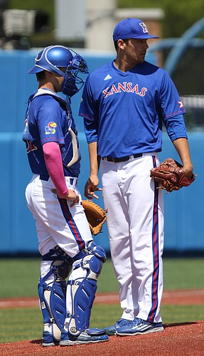 Kansas University starter Jackson Goddard and catcher Michael Tinsley talk during the third inning as the Texas Tech runs begin to pile up on Saturday, May 7, 2016 at Hoglund Ballpark.