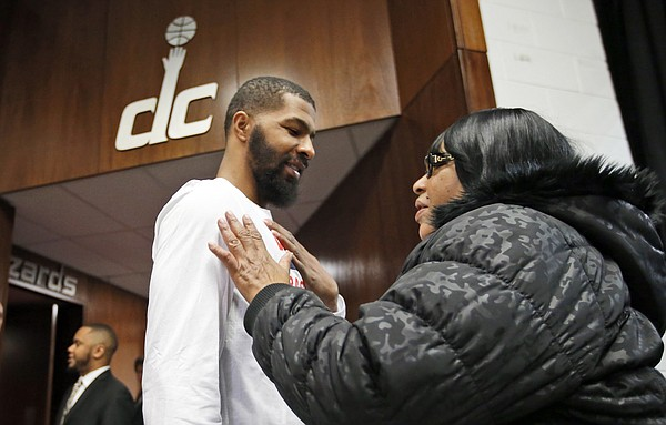 Washington Wizards forward Markieff Morris, front left, talks with his mother Angel Morris, from Clinton, Md., before an NBA basketball game against the Detroit Pistons, Friday, Feb. 19, 2016, in Washington. Markieff just joined the team in a trade from the Phoenix Suns. (AP Photo/Alex Brandon)