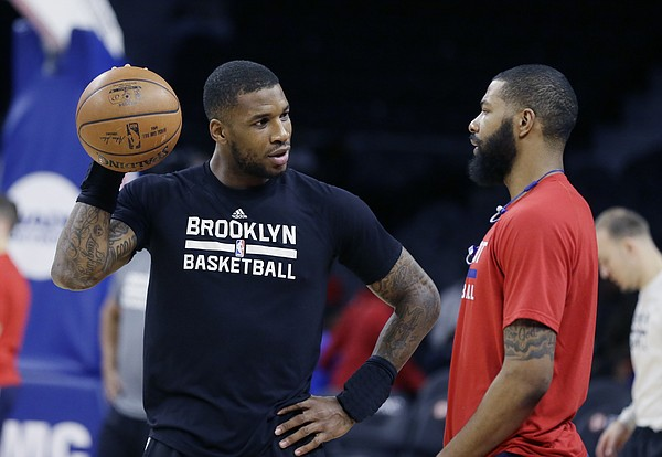 Brooklyn Nets forward Thomas Robinson, left, talks with Detroit Pistons forward Marcus Morris during pre game of an NBA basketball game, Saturday, March 19, 2016, in Auburn Hills, Mich. (AP Photo/Carlos Osorio)
