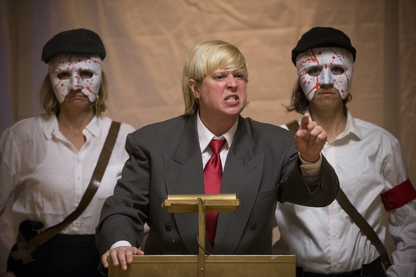 """Flanked by two bodyguards played by Jennifer Bennett, left, and Dorian Logan, Arturo Ui, played by Kitty Steffens, delivers a blistering campaign speech during a dress rehearsal for """"The Resistible Rise of Arturo Ui"""" on Wednesday, May 11, 2016 at the Fraternal Order of Eagles Lodge, 1803 W. Sixth Street."""