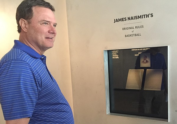 "Kansas University men's basketball coach Bill Self gets his first glimpse of the newly installed rules of ""Basket Ball"" at the DeBruce Center on Friday, May 13, 2016. The historic document, handwritten by James Naismith, was put into place a few hours earlier."