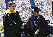 From left,  Brian McClendon received a Doctor of Science for outstanding contributions to fields of electrical engineering and computer science from Chancellor Bernadette Gray-Little during KU's 144th graduation on Sunday, May 15, 2016.