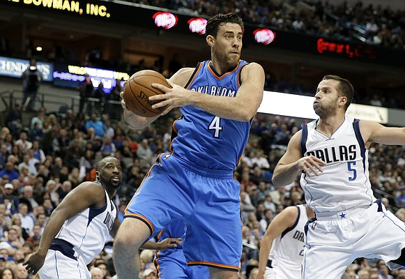 Oklahoma City Thunder forward Nick Collison (4) comes down with a rebound in front of Dallas Mavericks' J.J. Barea (5) of Puerto Rico during an NBA basketball game, Friday, Jan. 22, 2016, in Dallas. (AP Photo/Tony Gutierrez)