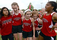 The Lawrence girls 4x800 relay team celebrates its second-place finish Friday during Regional track and field at ODAC.