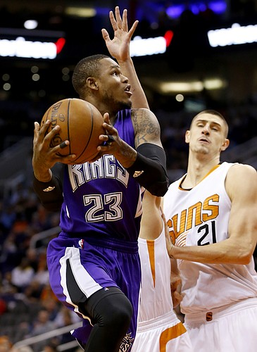 Sacramento Kings guard Ben McLemore (23) drives past Phoenix Suns center Alex Len (21) during the first half of an NBA basketball game, Monday, April 11, 2016, in Phoenix. (AP Photo/Matt York)